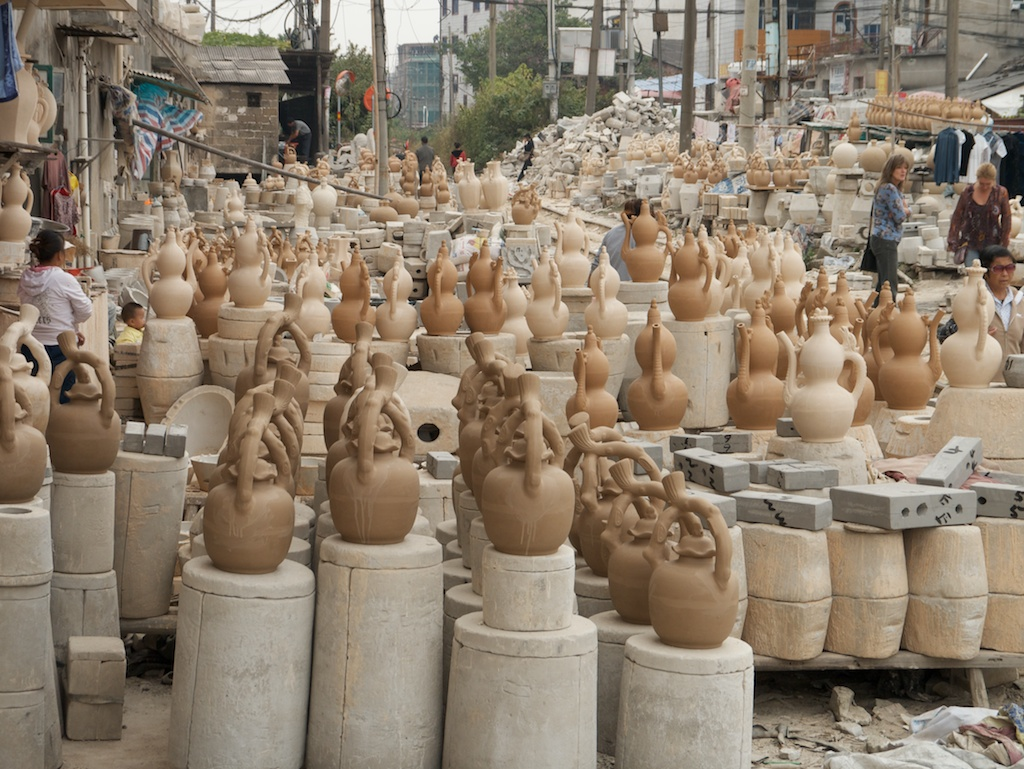 Slip-cast pottery and moulds line the railway that cuts through the Old Factory, Jingdezhen