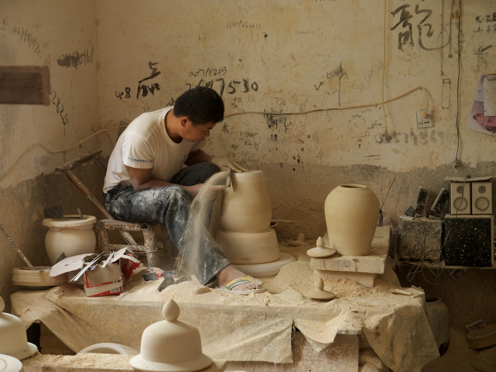 Trimming ceramics on the wheel in the Old Factory, Jingdezhen
