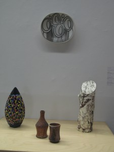 Works by Ryan McKerley (on wall), Grace Nickel, faculty at University of Manitoba, and wood-fired forms by U of M student Vera.